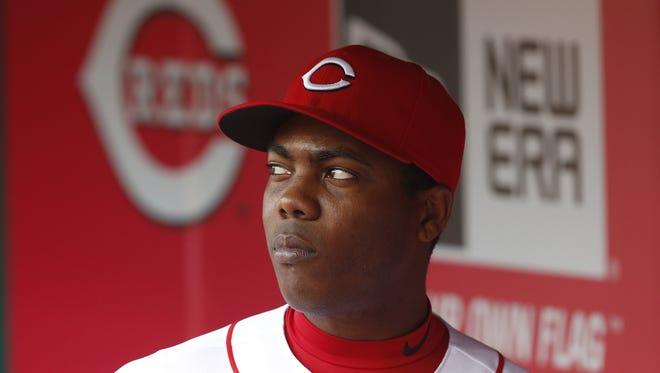 Cincinnati Reds relief pitcher Aroldis Chapman (54) hangs in the dugout.