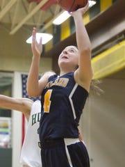 Hartland sophomore Emily Messner makes this basket