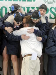 "Dallastown swimming coach Rich Howley leaps into the arms of his student-athletes. ""I always wanted to make a difference in the life of a child,"" Howley said. ""Hopefully, I did."""
