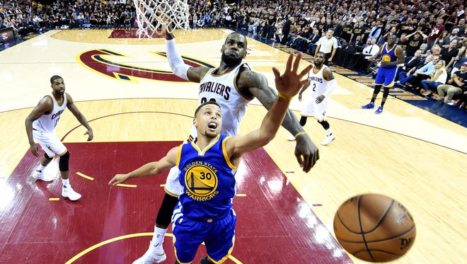 Cleveland Cavaliers forward LeBron James (23) blocks a shot by Golden State Warriors guard Stephen Curry (30) during the fourth quarter in  Game 6.