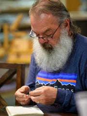 Randy Glick knits with the Wednesday morning knitting