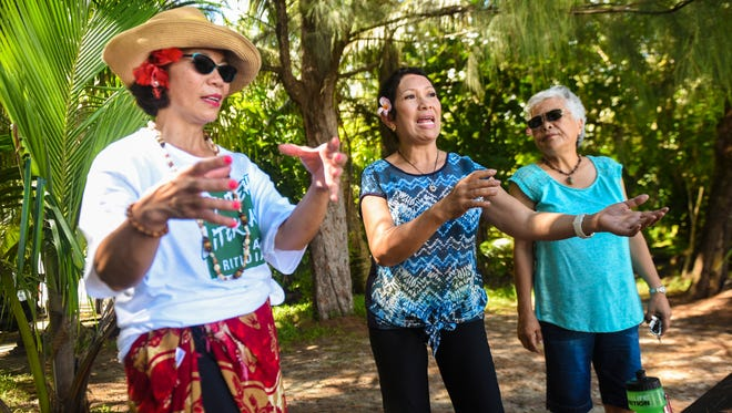 Sisters, Theresa Bejado Nellis, left, and Lou Flores Bejado, recount memories as children fishing in the waters off Litekyan, along with their cousin, Catherine Flores McCollum, right, on Thursday, Aug. 31, 2017. Litekyan, is now known as the Guam National Wildlife Refuge - Ritidian Unit. The trio say they are decendants of Benigno Leon Guerrero Flores, familian Apu, who they claim was the original owner of a large portion of the parcel, prior to the land being taken by the federal government.
