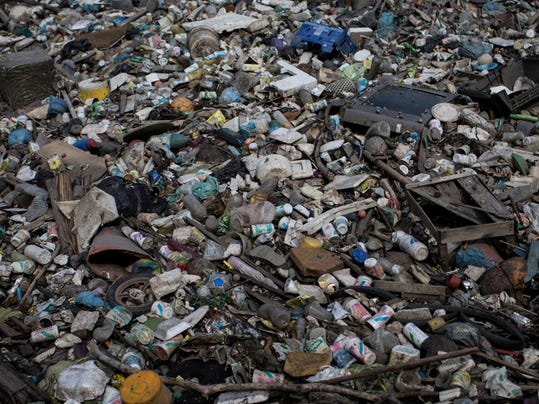 In this May 15, 2014 photo, trash floats on a polluted water channel that flows into the Guanabara Bay in Rio de Janeiro, Brazil. With just over two years to go until the Rio Olympics, nearly 70 percent of the sewage in the metropolitan area of 12 million inhabitants continues to flow untreated, along with thousands of tons of garbage daily, into area rivers, the bay and even Rio's famed beaches like Copacabana and Ipanema.Several Olympic sports federations raised fears that Rio's polluted waters could prove harmful to athletes' health. Exposure to fecal matter can cause Hepatitis A, dysentery, cholera other diseases. (AP Photo/Felipe Dana)