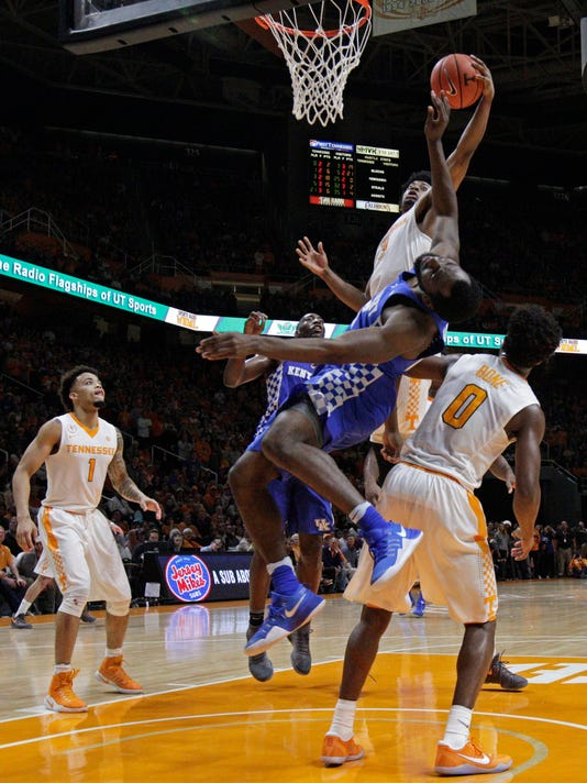 Tennessee guard Robert Hubbs III (3) grabs a rebound over Kentucky guard Malik Monk (5) during the second half of an NCAA college basketball game Tuesday, Jan. 24, 2017, in Knoxville, Tenn. Tennessee won 82-80. (AP Photo/Wade Payne)
