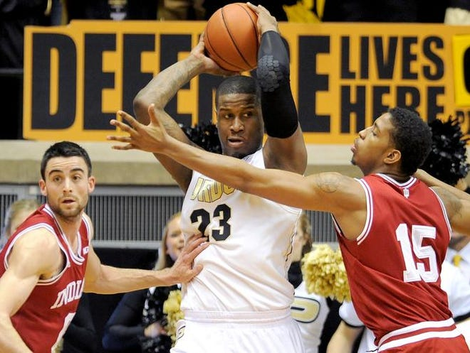 Purdue forward Jay Simpson is pressured by Indiana forward Devin Davis (15) and Will Sheehey inside Mackey Arena, Saturday, February 15, 2014, in West Lafayette.