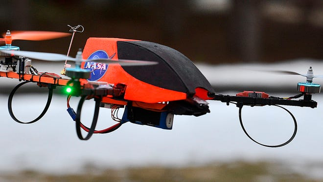 Rob Jahnke hovers his tricopter drone with a 720p video camera mounted to the front of it on March 11 near his Sartell home. While Jahnke is a hobbyist, he would also like to be able to use the devices commercially, which is currently prohibited unless a user obtains an exemption. He, like many others, is waiting for the finalization of new rules from the FAA.