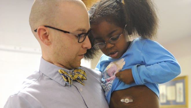 Tim Hilterman holds Brielle Trice, 4, in March 2015 before donating his kidney to the girl that summer. The two attend the same church, Westwood Alliance.