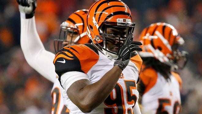 Cincinnati Bengals defensive end Wallace Gilberry (95) hushes the crowd after a Broncos penalty in the second quarter of the NFL Week 16 game between the Denver Broncos and the Cincinnati Bengals at Sports Authority Field at Mile High in Denver on Monday, Dec. 28, 2015.