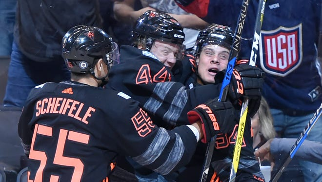 Team North America forward Auston Matthews (34) is greeted by defenceman Morgan Rielly (44) and forward Mark Scheifele (55) after scoring against Russia in the first period of preliminary round play in the 2016 World Cup of Hockey at Air Canada Centre on Monday.