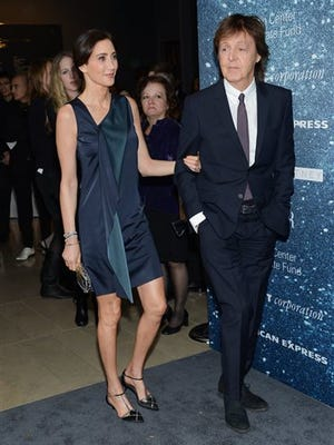 """In this photo, Sir Paul McCartney and wife Nancy Shevell arrive at """"An Evening Honoring Stella McCartney"""" presented by American Express, benefiting the Lincoln Center Corporate Fund, at Alice Tully Hall in New York. McCartney is 72, and only the wrinkles give his years away. He's so young in his thoughts that he will dismiss the idea of a memoir as a project for his 70s, catch himself, and dismiss a book again as if time were still a distant bother."""