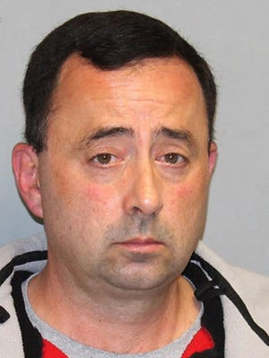 This Nov. 21, 2016 file photo provided by the Michigan Attorney General's office shows former USA Gymnastics team doctor Larry Nassar. Nassar, who has been accused of sexually abusing gymnasts, was hit with a new lawsuit filed in federal court in western Michigan on Tuesday, Jan. 10, 2017, by 18 women and girls who say they were molested by him, mostly at his clinic at Michigan State University.