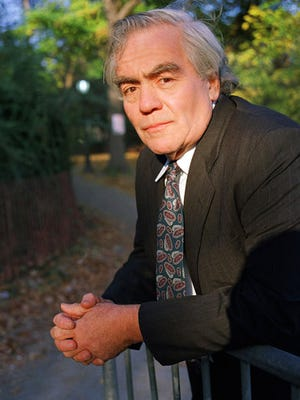 Author-columnist Jimmy Breslin poses for a photo in New York. Breslin, the Pulitzer Prize-winning chronicler of wise guys and underdogs who became the brash embodiment of the old-time, street smart New Yorker, died Sunday, March 19, 2017. His stepdaughter said Breslin died at his Manhattan home of complications from pneumonia. (AP Photo/Wyatt Counts, File)