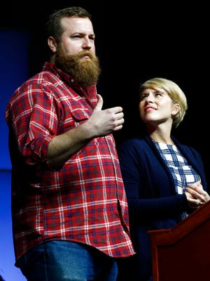 "Ben Napier, left, and his wife Erin, from the HGTV home renovation series, ""Home Town,"" based in their hometown of Laurel, Miss., speaks at a spring meeting luncheon of the Mississippi Economic Council, Thursday, April 27, 2017, in Jackson, Miss. The couple encouraged small businesses to invest in their communities in order to make a positive impact."