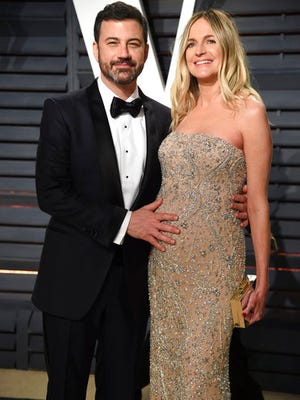 FILE - This Feb. 27, 2017, file photo shows Jimmy Kimmel, left, and his pregnant wife Molly McNearney at the Vanity Fair Oscar Party  in Beverly Hills, Calif. The hole-in-the-heart problem that plagues comedian Jimmy Kimmel's newborn son is one of the most common heart-related birth defects, and it usually can be fixed with surgery. On his show Monday night, the comedian tearfully described the emergency operation needed after his son, William John, was born on April 21.