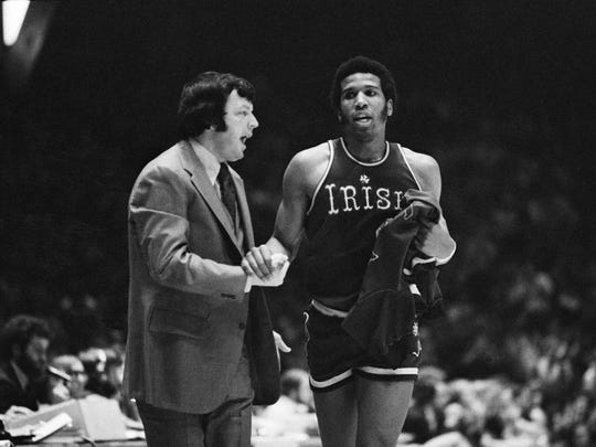 Notre Dame coach Digger Phelps congratulates his star Adrian Dantley, who leaves the game with a minute left against LaSalle College in Philadelphia, Feb. 5, 1976.