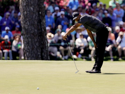 Tiger Woods misses a birdie putt on the 15th hole during the first round at the Masters golf tournament Thursday, April 5, 2018, in Augusta, Ga. (AP Photo/David J. Phillip)