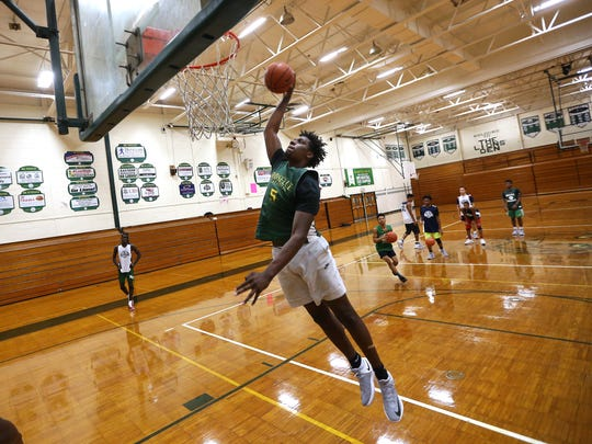 Asbury Park native Nazreon Reid goes up for a dunk during practice. Reid, a  6-11 junior forward for Roselle Catholic High School is the No. 1 basketball recruit in the state as well as one of the top in the country. Dec. 6, 2016, Roselle, NJ.