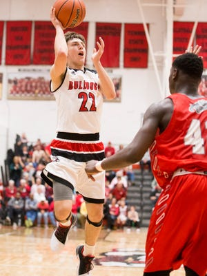 New Albany's Isaac Hibbard (22) shoots the ball during the game between New Albany and Evansville Bosse at New Albany High School.