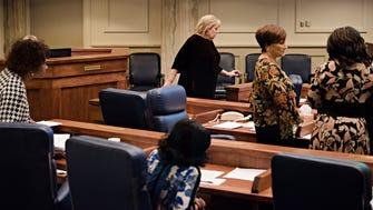 Harri Anne Smith, I-Slocomb, back center, walks the floor during the Alabama Legislative session on Thursday, Feb. 15, 2018, in Montgomery, Ala.
