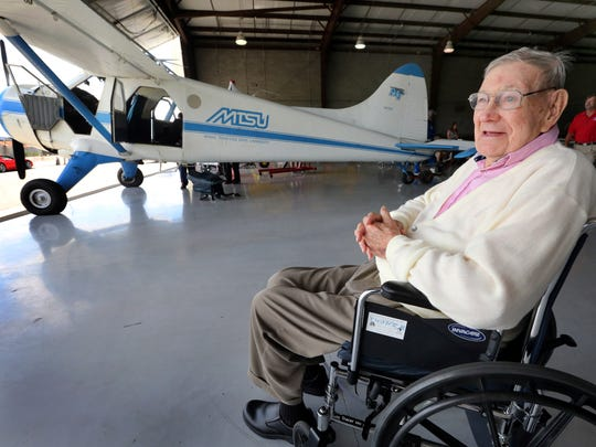 World War II veteran Harold Thune, waits to be loaded onto a de Havilland Canada DHC-2 Beaver, in the background,  at the Murfreesboro airport, on Wednesday July 16, 2014. Two veterans were able to fly on this aircraft on 2 separate flights that were organized by the Tennessee State Veterans' Home.