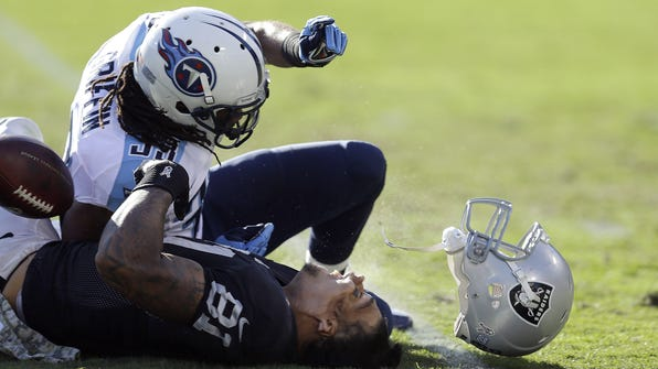 Titans safety Michael Griffin was suspended one game — costing him $205,882 — for this helmet-popping hit on Raiders tight end Mychal Rivera last season.
