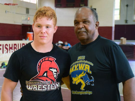 Riverheads' Hunter Sams, seen here with Carl Adams this past summer at a camp, won a state championship at 145 pounds Saturday, helping the Gladiators place third overall in Class 1.