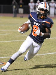 Blackman's Jamis Carson looks for running room during