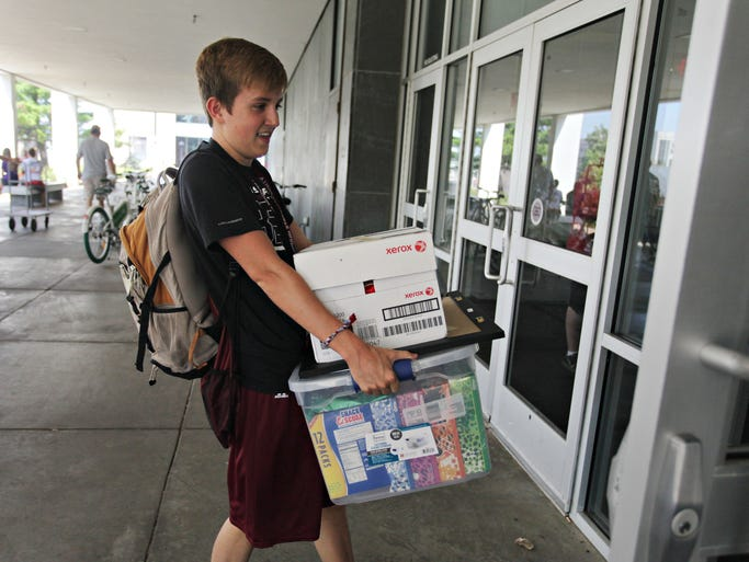 MSU Freshman Adam Woolstenhulme of Jefferson City moves into his dorm on Friday, August 15, 2014.