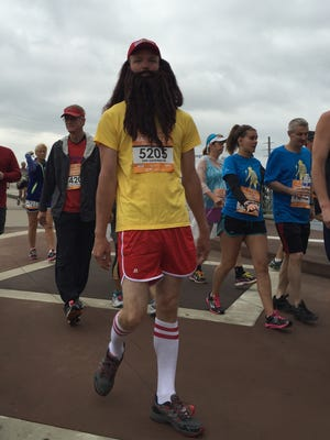 David Sumners dressed as Forrest Gump during the St. Jude Country Music Marathon.