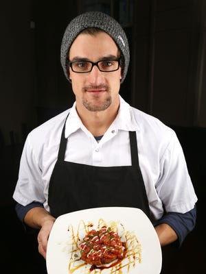 Chef Bradley Rodriguez of Skratch Eatery, Bar and Lounge in Asbury Park with his sushi tuna pizza.