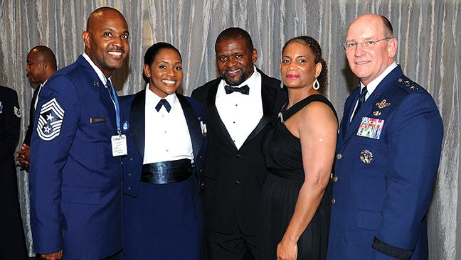 Staff Sgt. Kresston Davis, second from left, was officially recognized as one of the 12 Outstanding Airmen of the Year for 2015 by the Air Force Association at its annual conference in Washington D.C. Sept. 14. Above, Davis and her parents are joined on the receiving line by AFRC Command Chief and former 908th Airlift Wing Command Chief Cameron Kirksey and AFRC Commander Lt. Gen. 'J.J.' Jackson.