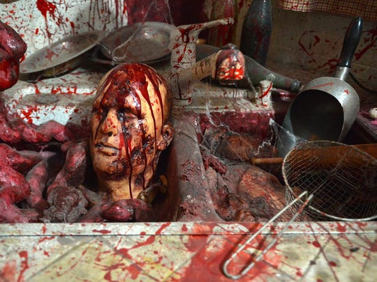 A grisly kitchen is part of the Reign of Terror haunted house.