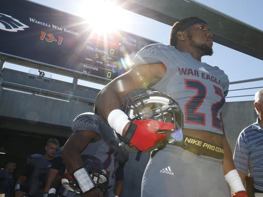 Wakulla's Monterious Loggins waits to charge onto the field at the Citrus Bowl to take on Bishop Moore during their Class 5A state championship game.
