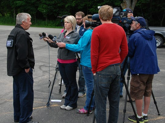 Door County Sheriff Terry Vogel briefs TV reporters at the Ephraim Fire Station Friday morning, after the rescue of a woman and two boys who had become lost while kayaking Thursday afternoon.
