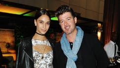 April Love Geary and Robin Thicke, pictured in October