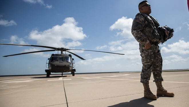 Corpus Christi Army Depot Commander, Colonel Allan H. Lanceta walks away from his helicopter after taking his final flight on Wednesday, July 18, 2018 at the Corpus Christi Army Depot.