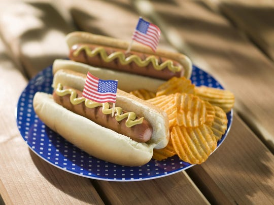 Hot dogs and chips with miniature american flags
