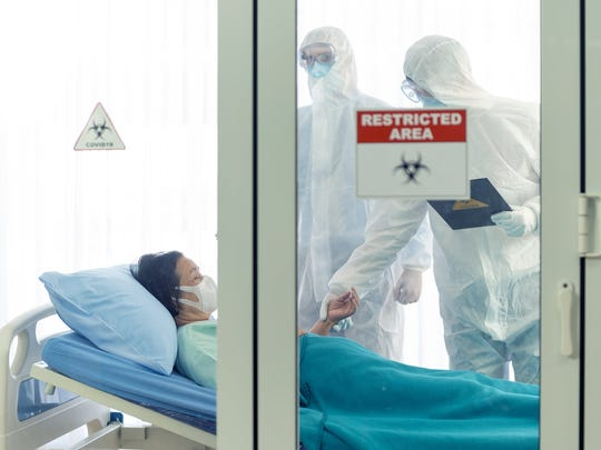 Patient and her doctors in a restricted area