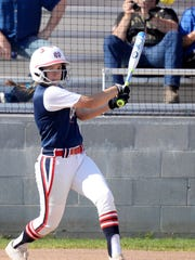 North DeSoto's Hailey Ebey wings during their game