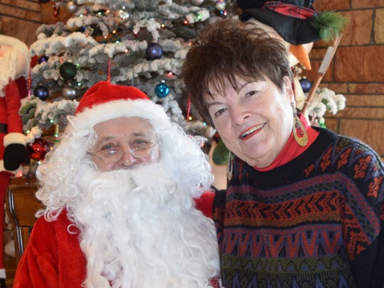 Santa Claus and Trish Clarke of Anderson attend the