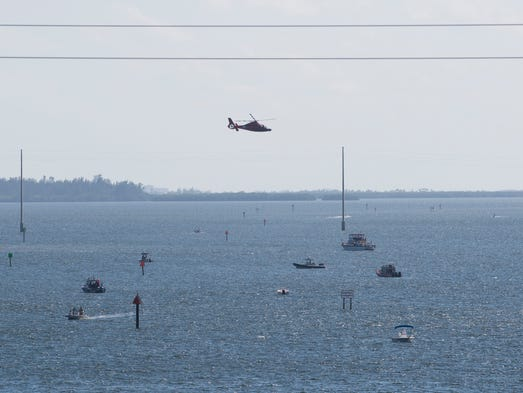 Rescue personnel search for a missing teen Sunday morning