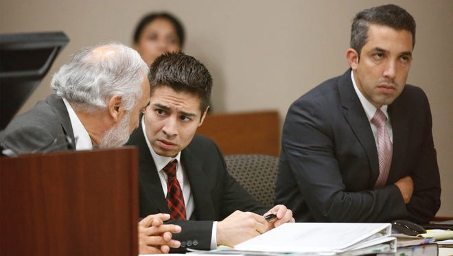Alberto Antonio Mendiola, center, talks with his attorney, Joe Spencer, left, as the jury leaves the courtroom for lunch Thursday during the fifth day of his trial in the 168th District Court. Mendiola is charged with killing a man in 2014 at his estranged wife's home.
