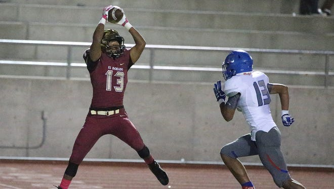 El Dorado wide receiver Corey McCoy, 13, leaps for a catch just a few feet from the end zone as Isaac Olmeda, right, of Americas arrives too late to prevent the score Friday night.