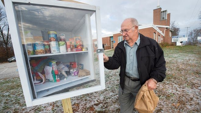 Lifelong member Dale Goodling of Springfield Township places a donation in the Community Pantry Box outside St. Paul Lutheran Church Hametown in Shrewsbury Township. The pantry box is available around the clock for anyone in need.