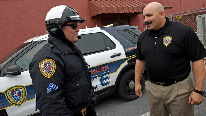 Chief Ron Camacho, right, chats with Cpl. Matt Bietsch behind Chambersburg Police Department on Dec. 12, 2016.