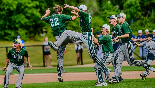 Members of the Portland St. Patrick baseball team leap in celebration of their Division 4 state semifinal win over Unionville-Sebewaing Friday, June 16, 2017, at McLane Stadium in East Lansing.