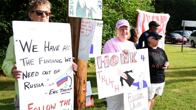A handfull of people gathered on the corner of Country Club Lane and North Highland to exercise their freedom of speech as Rep. David Kustoff (TN-08) spoke at the Jackson Country Club for his legislative update, Wednesday, Aug. 16.