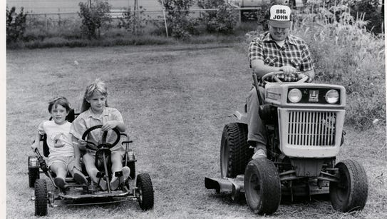 Kelli and Kari Gallagher ride along with their uncle