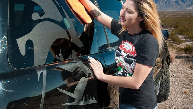 Luz Reza, 20, wipes off her black SUV adorned with a Darth Vader decal on Wednesday. The Star Wars fan is seeking to legally change her last name to Skywalker.