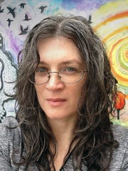 Artist Angie Reed Garner is a partner with Joyce Garner,